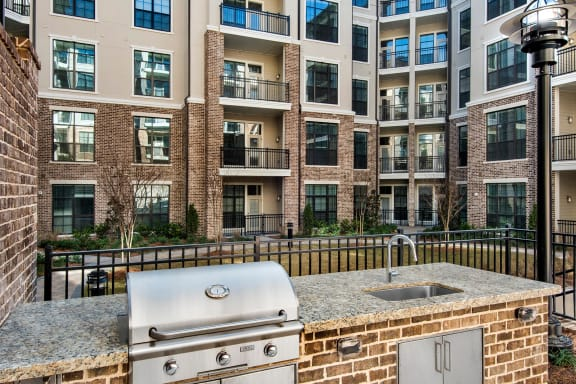 Courtyards with Grilling Stations and Firepit at Windsor Chastain, GA, 30342