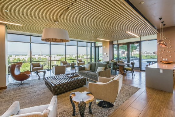 Clubroom with Multiple TVs Overlooking the Pool Deck at 1000 Speer by Windsor, Colorado, 80204