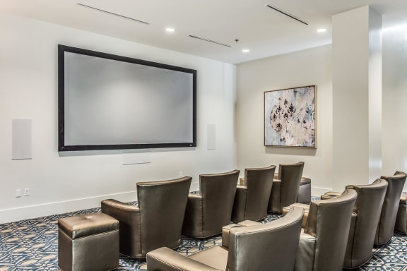 "Media Room with 135"" Quad-Screen Projector at Glass House by Windsor, Dallas, TX"
