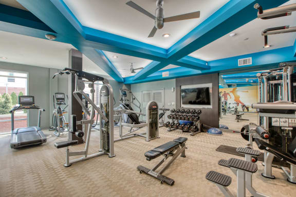 Fitness center at Centric Lohi by Windsor, CO, 80211