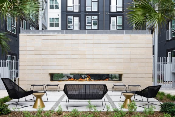 Courtyards with Gathering Spaces, Fire Pits and Hammocks, at Metro West, Plano, 75024