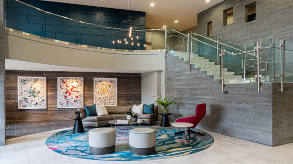 Lobby seating and stairs at Windsor at Contee Crossing, Laurel, MD