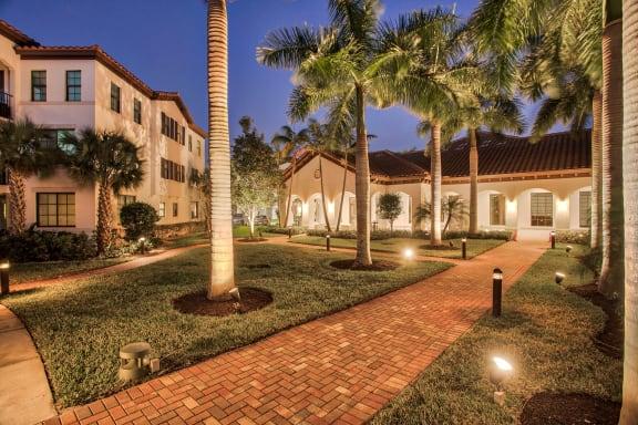 Courtyard at twilight at Mirador at Doral by Windsor, Florida, 33122