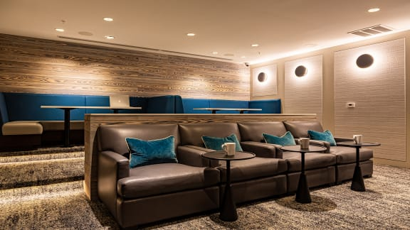 Media room with seating at The Ridgewood by Windsor, Fairfax, VA