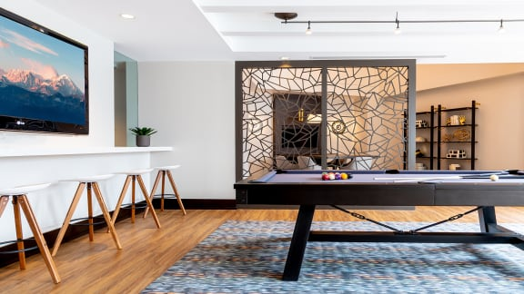 Game room with billiards at The Ridgewood by Windsor, Fairfax, Virginia
