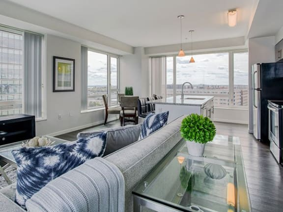 Spacious open layouts with charcoal wide plank wood flooring in the B5 Floor Plan at Waterside Place by Windsor, 505 Congress St, Boston