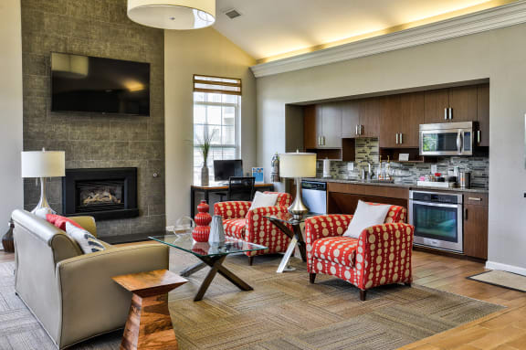 cozy clubhouse with fireplace at The Villas at Main Street Apartments in Ann Arbor, MI