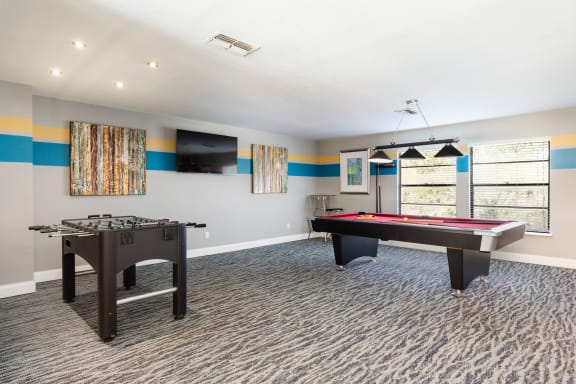 Game room with billiards table and Foosball table.
