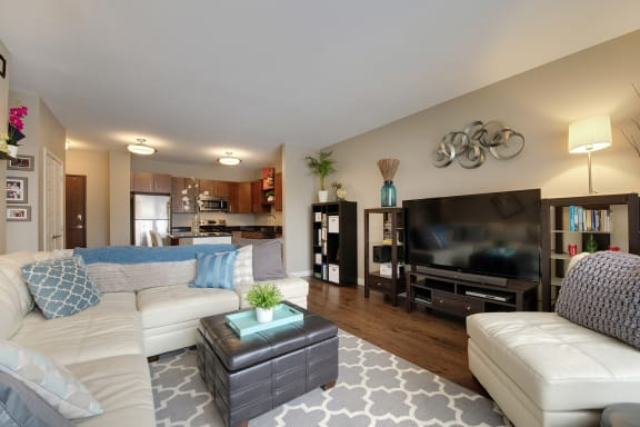 Be @ The Calhoun Greenway Apartment Living Room with Open-Concept sight line into Kitchen