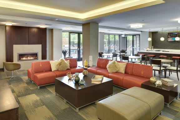 Be @ The Calhoun Greenway Community Room with comfy chairs, couches, coffee table, and fire pit