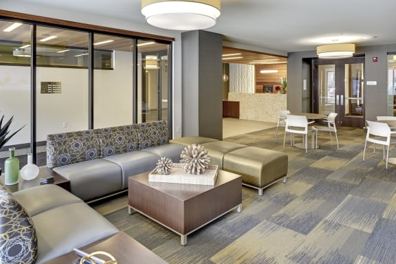 Be @ The Calhoun Greenway Lounge Area with couches, chairs, and coffee table