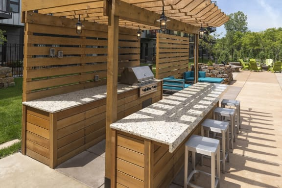 Be @ The Calhoun Greenway Grill Area with Granite Counter Tops and Bar stools