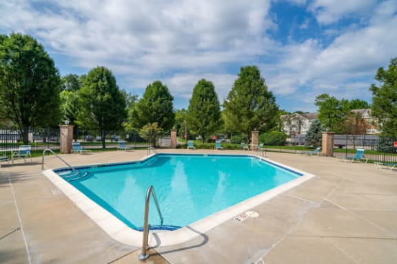 Outdoor Swimming Pool with Large Sundeck and Wi-Fi at The Highlands Apartments, Elkhart