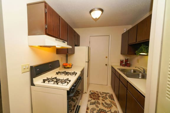 Kitchen with Gas Range at Madeira Apartments in Kalamazoo, MI 49001