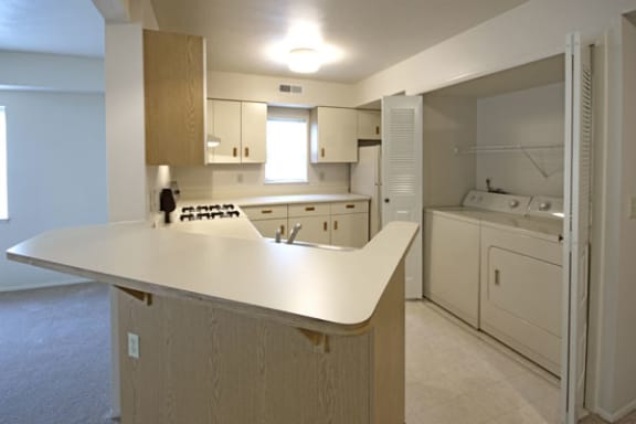Spacious Kitchen with Breakfast Bar at Dupont Lakes Apartments in Fort Wayne, IN