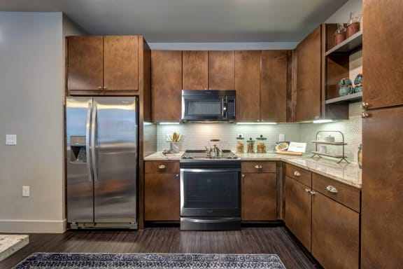 Fully Furnished Kitchen With Stainless Steel Appliances at Berkshire Auburn, Dallas