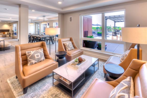 Ellison Apartments Clubroom with work-from-home suite, coffee barm game room, pool and fitness center, Des Plaines, Illinois