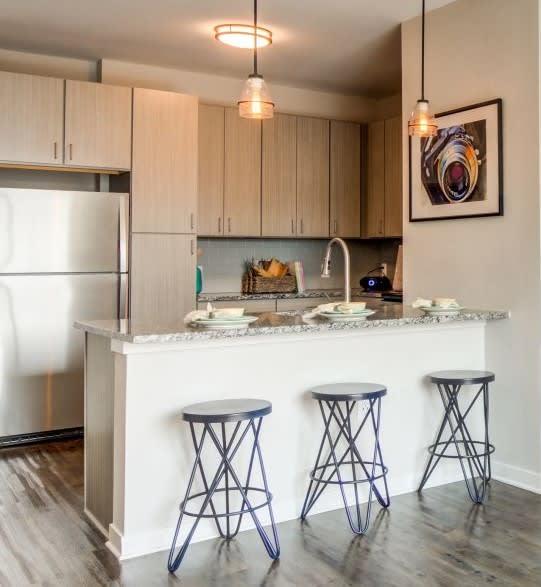 Classic granite or distinctive quartz countertops and subway tile backsplash at Spoke Apartments in Atlanta, GA