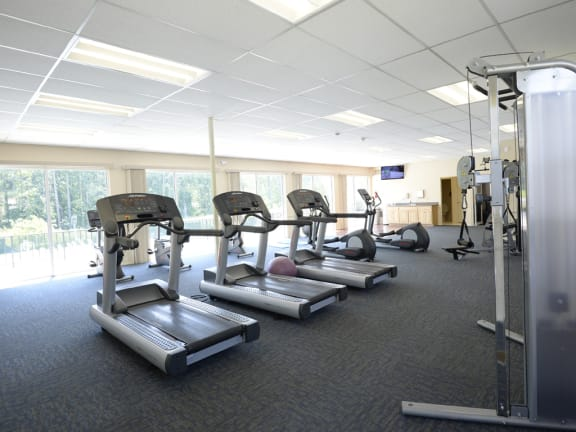 Fitness Center with Outside view at Woodridge Apartments, 3901 Noyes Circle, MD 21133