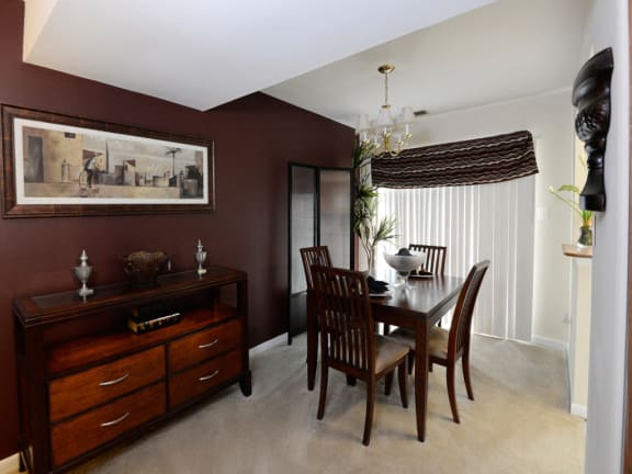 Open concept living room and dining room at McDonogh Village Apartments