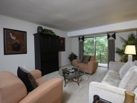 Large living room with private balcony at Liberty Gardens