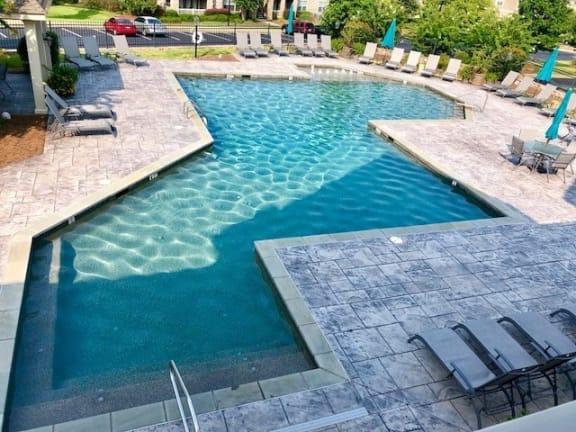pool area with sun deck