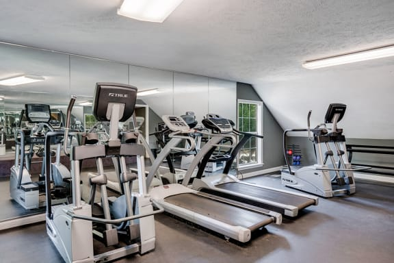 Fitness Center with Large Floor to Ceiling Mirrors
