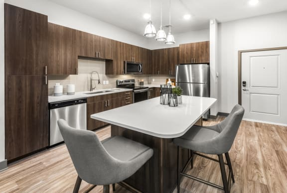 Well Equipped Kitchen And Dining at Monterosso Apartments, Kissimmee, FL