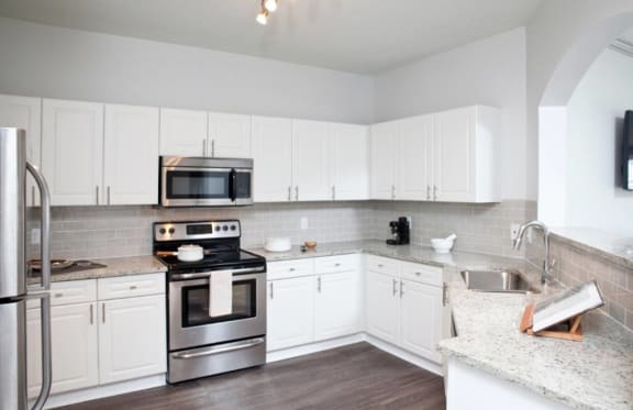 Upgraded Kitchen with Stainless Steel Appliances at The Estates at Johns Creek, Alpharetta