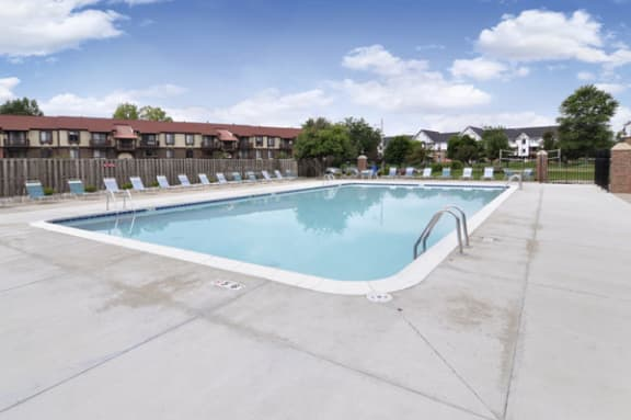 Outdoor Pool with Lounge Chairs at West Wind Apartments in Fort Wayne, Indiana