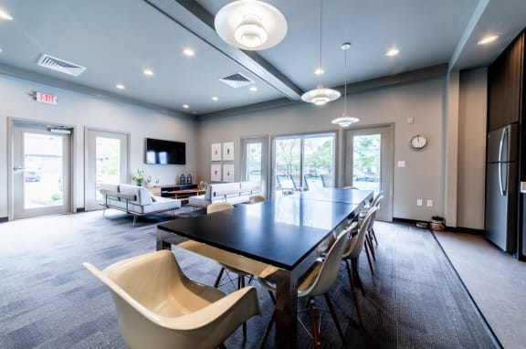 Eat-In Table With High Chairs In Clubhouse at Woodbridge Apartments, Louisville, KY, 40242