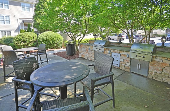 Outdoor Grill With Intimate Seating Area at Sterling Magnolia Apartments, North Carolina, 28211