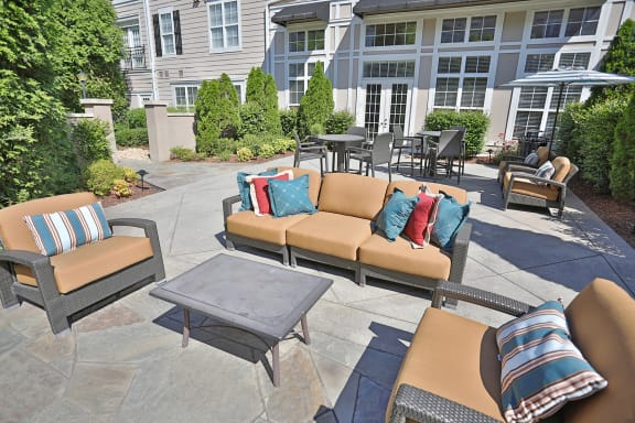 Outdoor Courtyard with Surrounding Foliage at Sterling Magnolia Apartments, Charlotte