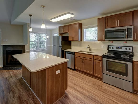 Cherry Cabinets in Kitchen at Cambridge Apartments, North Carolina, 27615