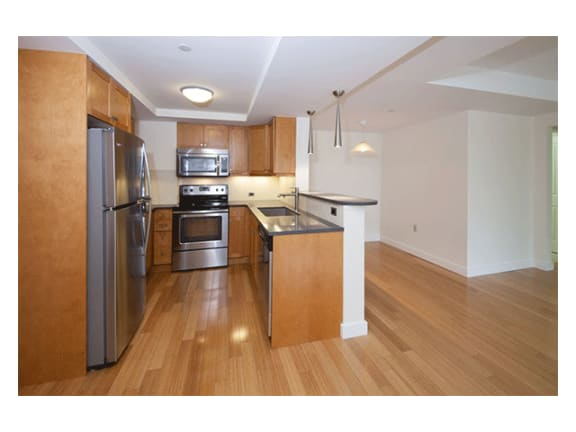 Stylish Maple Cabinetry in Kitchens with Laminate, Wood Trimmed Countertops at Marion Square, Massachusetts, 02446