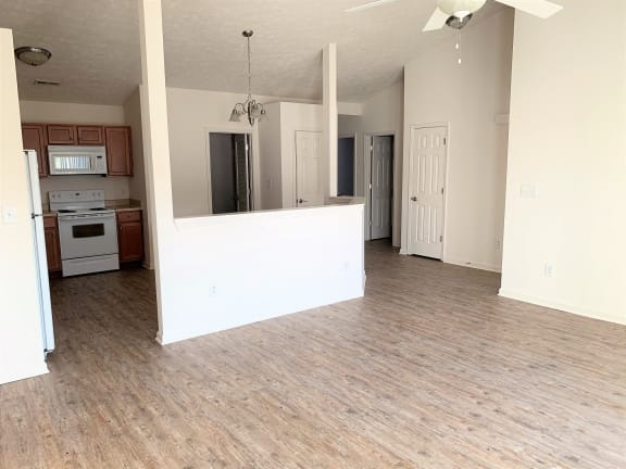 Living Room Into Kitchen View - upgraded flooring  at Hawthorne Properties, Indiana