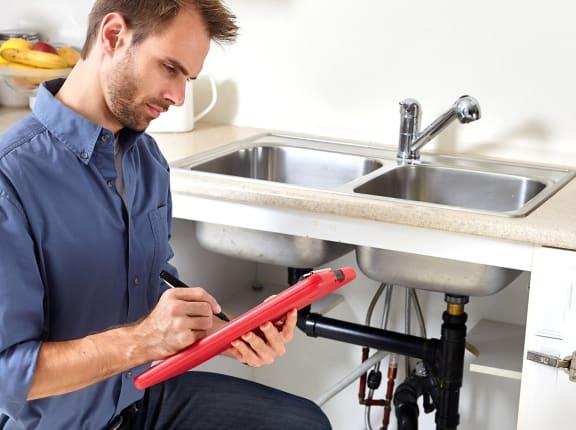 maintenance man taking notes
