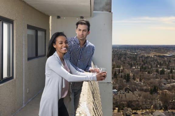 couple smiling on balcony