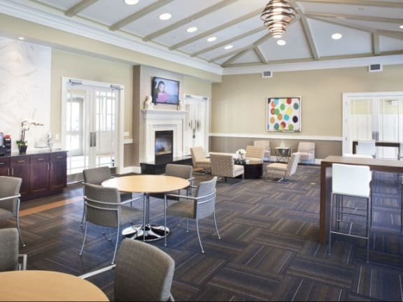 Stunning resident clubhouse with conversational seating at `Windsor at Oak Grove, Melrose, MA 2176