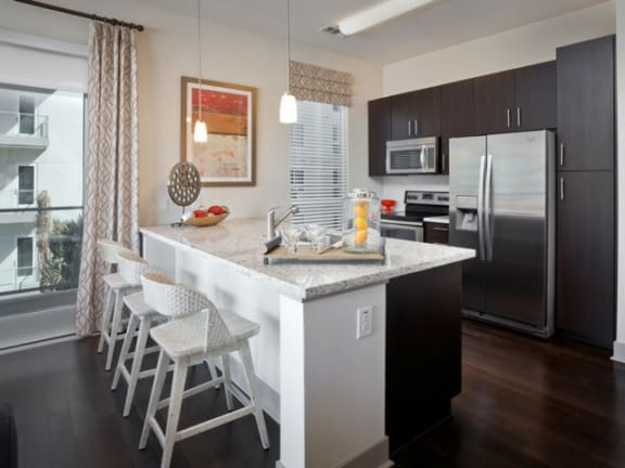 Gourmet Kitchens with Islands, Caesarstone Countertops, and Decorative Backsplash at South Park by Windsor, Los Angeles, CA 90015