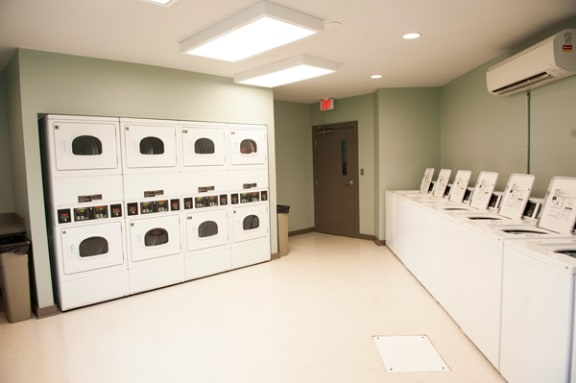 Laundry Center with Machines Next to Folding Counter at Sterling Beaufont Apartments, Richmond, 23225
