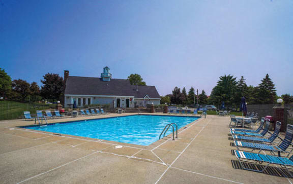 Shimmering Swimming Pool with Wrap-Around Sundeck at Apple Ridge Apartments in Walker, Michigan