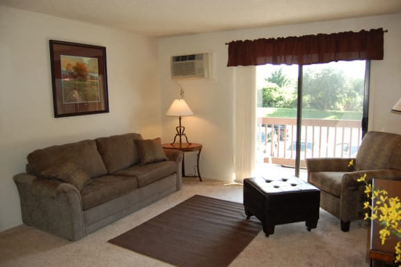 Spacious Living Room with Balcony at Apple Ridge Apartments in Walker, MI