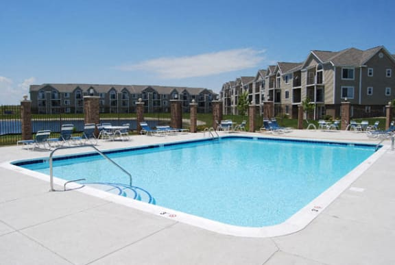 Refreshing Pool With Sundeck at Hunters Pond Apartment Homes in Champaign, IL