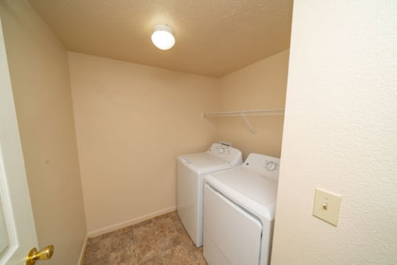 Separate Laundry Room in Two Bedrooms at Trillium Pointe Apartment Homes in Jackson, MI