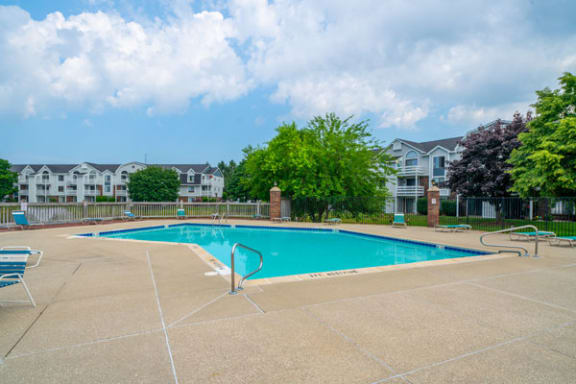 Outdoor Swimming Pool and Large Sundeck at Windmill Lakes Apartments, Holland, Michigan 49424