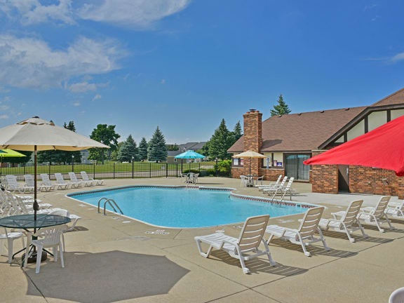 Outdoor pool with sundeck at Thornridge Apartments in Grand Blanc, Michigan