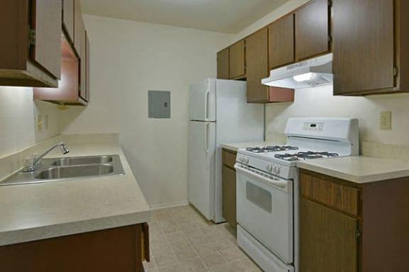 Well Equipped Kitchen with White Appliances at Cordoba Apartments, Farmington Hills