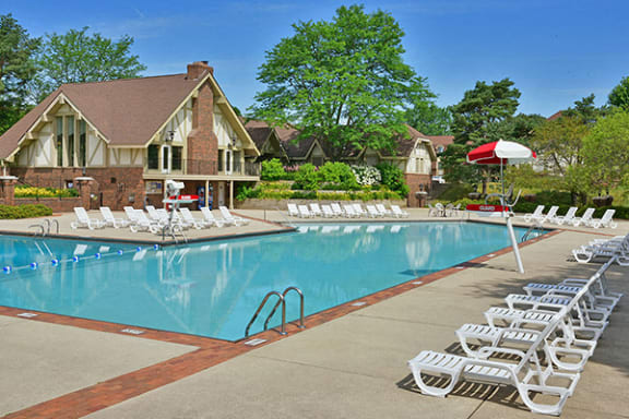 Outdoor Swimming Pool and Lounge Chairs at The Village Apartments, Wixom 48393