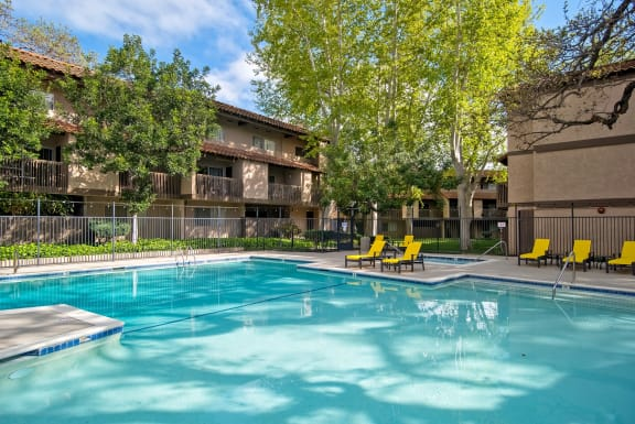 Swimming Pool Area With Chairs at Wilbur Oaks Apartments, Thousand Oaks, 91360
